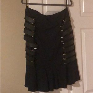 Skirt with leather details on the sides
